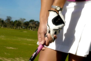 Woman showing how to play golf